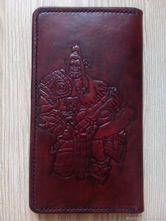 """Кошелек """"Warcraft"""" с тиснением из кожи растительного дубления ручной работы. Leather wallet with carving."""