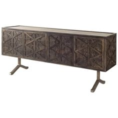 Exceptionally crafted frompremium Indian hardwood finished in a dark brown stain, the Hollandsworth is a four-door sideboard mounted on two nickel plated iron feet. Each door on the Hollandsworth showcases an intricate, geometrical pattern which give Solid Wood Cabinets, Wooden Cabinets, Wood Buffet, Farmhouse Buffet, Buffet Tables, Side Tables, Mid Century Sideboard, Sideboard Cabinet, Credenza