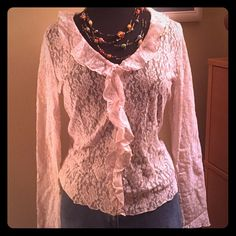 Long sleeve lace top beige This is a long sleeve lace top. It is size large.  The color is a beige-tan. It has a ruffle around the neckline and all the way down the front. It is a pullover top. You can create a variety looks by wearing a different color camisole underneath. Jones New York Tops Blouses
