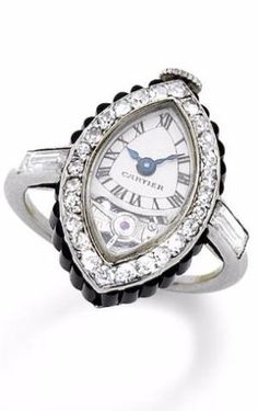"A rare art deco onyx and diamond ""Montre Bague Navette"" keyless ring watch, by Cartier, circa 1920 The ""ship"" case set with shaped onyx batons, the dial with Roman numerals, blued steel hands and visible balance, within a single-cut diamond bezel, the crown decorated with rose-cut diamonds, mounted in platinum, dial signed Cartier, French assay mark. by penelope"