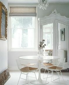 Eclectic Mix - Ikea Docksta Table, Contemporary Wire Chairs, Chandelier and Vintage Armoire.