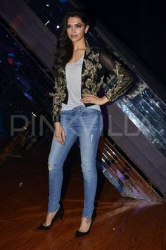 Deepika Padukone in a grey tank from Forever 21, distressed J Brand jeans, and a jacket from Falguni & Shane Peacock. The jacket is gorgeous
