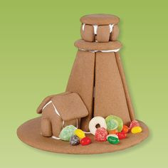 a gingerbread house built into the shape of a lighthouse
