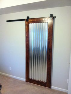 Frames corrugated metal for door.....Starglen Ct. - contemporary - spaces - nashville - Gettin Hammered Handyman Service