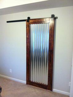 Frames corrugated metal for door.....Starglen Ct. - contemporary - spaces - nashville - Gettin Hammered Handyman Service