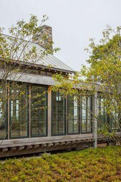 Neutral palette - dark windows . Architecture by Hutker Architects (Stoney Beach)