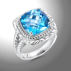 Swiss Blue Topaz Ring - A Majestic Sterling Silver 12 mm Faceted Blue Topaz Cocktail Ring.