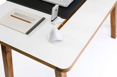 StudioDesk features a white laminate desktop with solid mahogany legs and accents