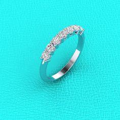 Platinum shared prong 0.55Ct Diamond band