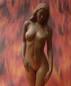 Sculpture of nude woman in hazel wood, by Carlos Baez Barrueto