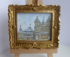 A framed, miniature original ink and watercolour painting of Buxton Opera House in the High Peak of Derbyshire, England.  It measures 7.5cm x