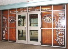 Custom designed, printed & installed perforated window murals for the entrance of Claymont High School in Claymont, OH