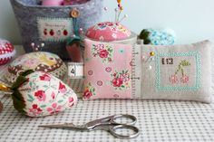 cherry stamp cross stitched pin cushion by nanaCompany