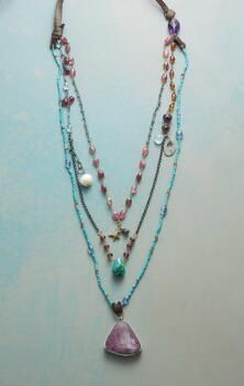 Pearl and shimmering gemstones rollick in this love-themed triple-strand necklace by Jes MaHarry.