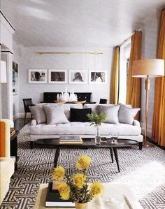Suzie: Elle Decor - Orange & gray modern living room. Love the graphic rug in this space with ...