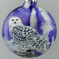 "The Snowy Owl is hand painted on this glass Christmas ornament by Wildlife Artist, Mary Jane Harman.  The background color is achieved by swirling paints on the inside of a glass ball. The Owl is painted on the outside of the ball with an acrylic enamel paint formulated for use on glass.  A thin coat of Indoor/Outdoor Clear Gloss Spar Urethane is applied to the finished painting to protect this beautiful ornament.  This is a ""canteen shaped"" Christmas ornament measures 3.15"" (80mm)."