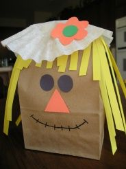 "The materials needed to create these ""Paper Bag Scarecrows"" are pretty easy to gather together: paper bag , construction paper, coffee filter , old newspapers, scissors, glue, and markers."