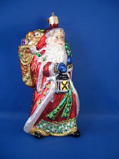 Radiant Santa Glass Merck Old World Christmas Ornament w/ lantern toys NWT 40185