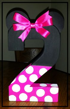 Minnie mouse inspired number photo prop and birthday decor. Made with an 8 paper mache number hand painted in your choice of light pink, hot