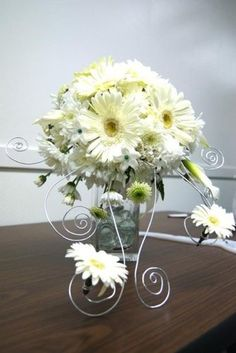 Whimsical and fun!   Gerber daisy mixed with daisy mums!