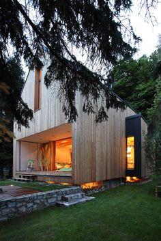 massive stone base concrete slab logs house