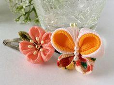 ご覧頂きありがとうございます。小さな女の子の好きな、桜の花と蝶々のパッチン留めです♪サーモンピンク色の桜と春らしい色合いの蝶々です。どちらか1点のお値段になります。お好きな方をオプションからお選びください。(2個セットだとちょっとお得に♪)入園式、入学式...