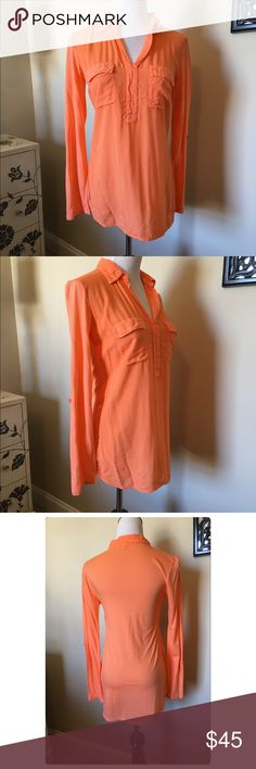 NWT, Splendid, Orange Tab-Roll Sleeve Top! NWT, Splendid Orange tab roll sleeve tunic/!top! 1/4 button down front closure, long-sleeve with optional roll tab sleeve, two front pockets. Wear as a top or a tunic! Self 100% rayon. Contrast 50% modal & 50% cotton. Size XS. 🚫No Trades Splendid Tops Blouses