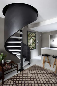 Cool staircase. I love spiral staircases and this one is really great.