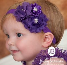 Searching for the perfect headband? We have created the most amazing floral headband Purple beautiful organza sating and shabby flowers and topped with amazing sparkling rhinestone jewels that gives this ultra girly headband a precious vintage look. The flowers are felt backed for extra confort and we have put them in a soft and stretchy whhite headband. For sure to be a real head turner!! Pair it with one of our adorable lace petti rompers for a complete look.