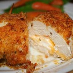 Not your everyday chicken dish! Stuffed with Cheddar and cream cheeses, then drenched with a garlic-lemon-butter sauce, your friends and family will be begging you to make this recipe - believe me, I know!.
