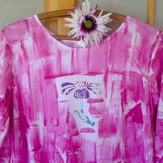 Pretty in pink!  Flowers never go out of season.  Lovely soft light cotton tunic with high low hem.  Hand Painted from Kaua'i Hawaii. Sized s - 2x.  Also available as a tank.Shown here in wildflower design on pink.