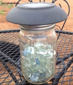 s 13 spectacular things to make for your yard using 1 solar lights, lighting, outdoor living, repurposing upcycling, These colorful pebble filled lamps