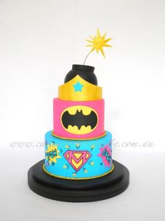 """https://www.facebook.com/cakemetoyourparty A 'Supergirl"""" themed party for a very lucky birthday girl. The Wonder Woman's Tiara and Exploding Bomb, were made as keepsakes. Chocolate mud cakes filled with cookies n' cream buttercream. Pictures of..."""