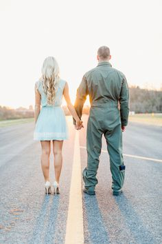 He wears flight suits, she wears high heels | JoPhoto | See more! http://heyweddinglady.com/patriotic-and-romantic-air-force-engagement-from...
