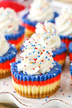 These Red, White and Blue Mini Cheesecakes are smooth, creamy and easy to make! Perfect for your of July patriotic celebration! via These Red, White and Blue Mini Cheesecakes are smooth, creamy and easy to make! Perfect for your patriotic celebration! Patriotic Desserts, Blue Desserts, 4th Of July Desserts, Fourth Of July Food, Mini Desserts, July 4th, Mini Cookies, Yummy Cookies, Yummy Treats