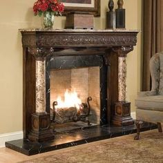Heavily carved mahogany fireplace surround with a beautiful emperador marble top and side columns