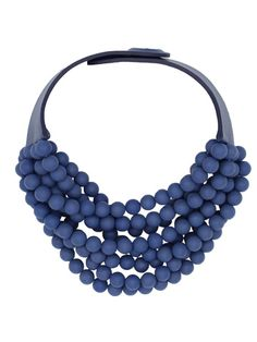 Multi strand necklace with Matte resin beads a leather collar and magnetic collar. Hand crafted in Italy.