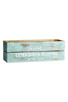Boîte en bois: Boîte en bois vieilli avec texte imprimé. Patins au-dessous. Le rendu patiné peut légèrement varier d'un article à l'autre. Dimensions 10x10x30 cm.