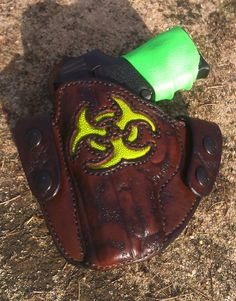 Custom holster with biohazard symbol inlay in stingray, leather distressed apocalyptic and stained antique dark brown. By C.B.'s Leather Works