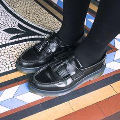 April wears the Adrian Dr. Marten shoe in black.