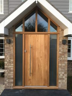 Oak Front door with oak sidelights manufactured by Medina Joinery Timber Front Door, Timber Roof, Timber Windows, Front Doors, Front Door Porch, D House, House With Porch, Facade House, House Front