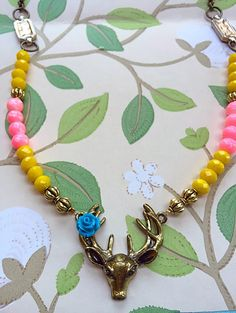 A personal favorite from my Etsy shop https://www.etsy.com/listing/233165057/boho-style-deer-head-beaded-necklace