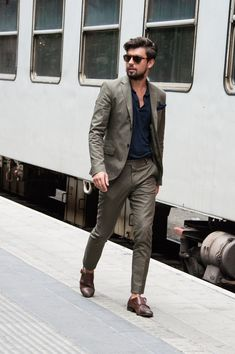 Something as simple as opting for an olive suit and a dark blue polo can potentially set you apart from the crowd. A pair of brown leather double monks will seamlessly integrate within a variety of outfits. Shop this look on Lookastic: https://lookastic.com/men/looks/olive-suit-navy-polo-brown-double-monks/17882 — Navy Pocket Square — Navy Polo — Olive Suit — Brown Leather Double Monks