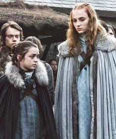 Maisie Williams as Arya Stark,  Sophie Turner as Sansa Stark In Game of Thrones - Season 1