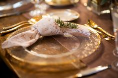 White Etched Velvet Napkin knotted with gold and glass charger