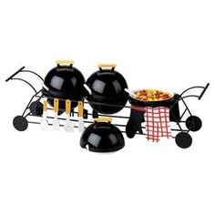"Set out spreads and dips for your next barbecue with this charming condiment server, featuring a grill-inspired design.  Product: 1 Stand and 3 condiment compartmentsConstruction Material: EarthenwareColor: BlackFeatures:  Party grill motifThree sectionsDimensions: 5"" H x 17"" W x 5"" D (overall)Note: Accents not included"