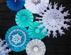 Celebrate the season with this festive, eye-catching backdrop made right here in our studio! Made out of sturdy cardstock and sustainable forestry tissue. Set of 8 tissue and paper fans in turquoise and white and silver in sizes 6-14 Tissue fans have string for hanging and paper