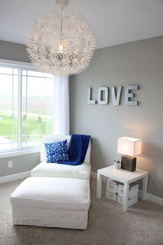 Grey room, white trim, brown furniture, gray-blue and silver curtains and accents for master bedroom