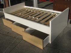 Sculpture of Beds with Drawers Underneath