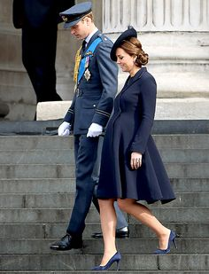 Pregnant Kate Middleton (with Prince William) works her baby bump in a blue wool coat while at the service at St. Paul's Cathedral on March 13.
